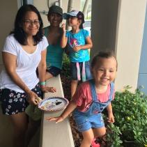 Auntie Flori, Mom, Naiatea & Lola finding shade from parade